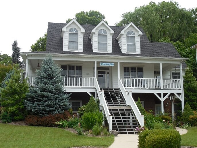 White house with a veranda and large staircase