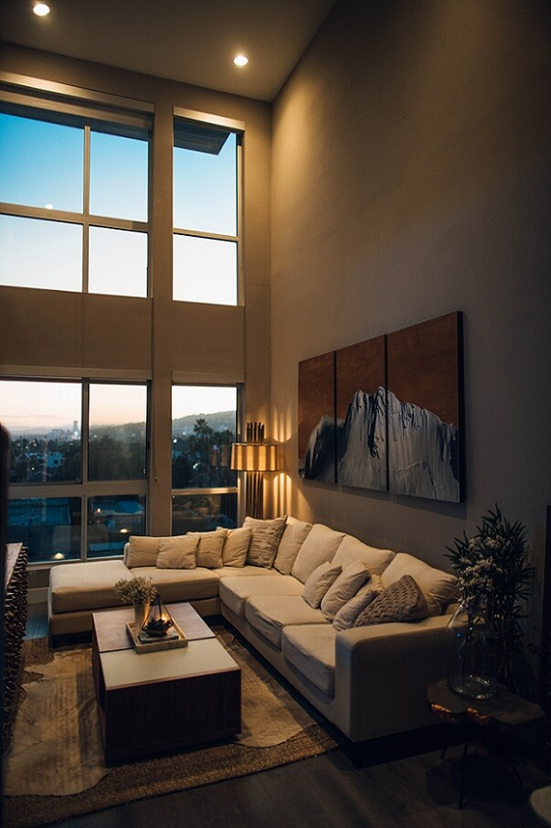 Room with tall ceilings and dim lighting