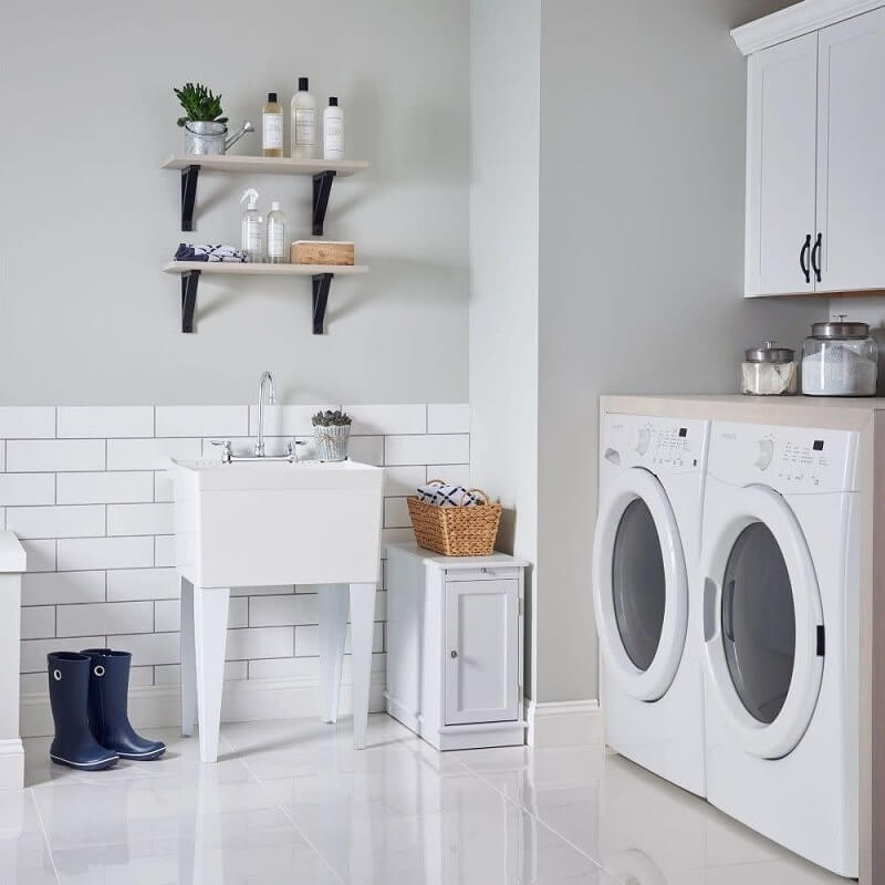 Functional laundry room with sink and storage